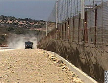 Israel says the barrier will stop Palestinian terrorists. Palestinians call it a land grab.
