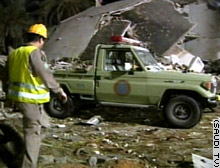 Workers sift the rubble at the site of the bombing Monday.