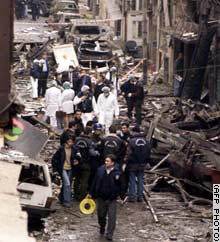 Turkish police search the rubble and debris for clues in the bombing near the Neva Shalom.