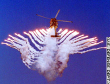 An SH-60 Sea Hawk, the Navy equivalent of the Army's Black Hawk, fires flares in an air power demonstration. The flares can distract heat-seeking missiles.