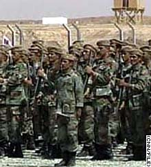 Members of the post-Saddam Iraqi army train in formation.