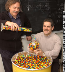 Professors Paul Chaikin, left, and Salvatore Torquato used M&M candies to reveal fundamental principles governing the random packing of particles.