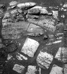 This rover Opportunity image shows the layered rocks of the